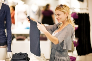 Young woman shopping for clothes.