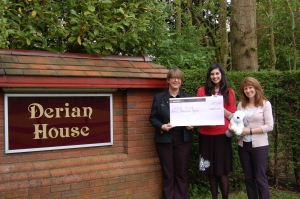 Janette Berry, English Lakes, and Leslie Starkey, The Midland, presenting £3,000 to Derian House