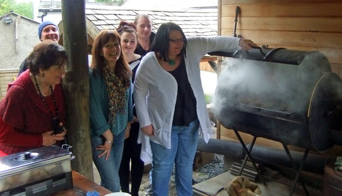 Denise opens The Wild Boars smoker with the rest of the smoking course group