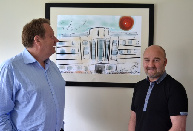 Artist, Neil Eckersley with Simon Berry, Chairman and Managing Director admiring the painting 'Bring Me Sunshine'.