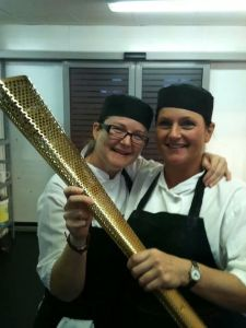 Sally and Sarah in the kitchen at The Midland.   (the olympic torch lent by a Midland guest)