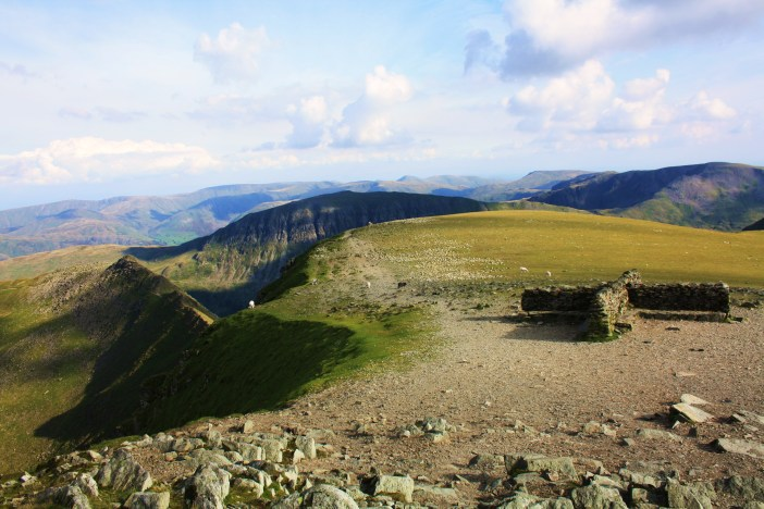 Helvellyn Summit Shelter with Striding Edge to the centre-left