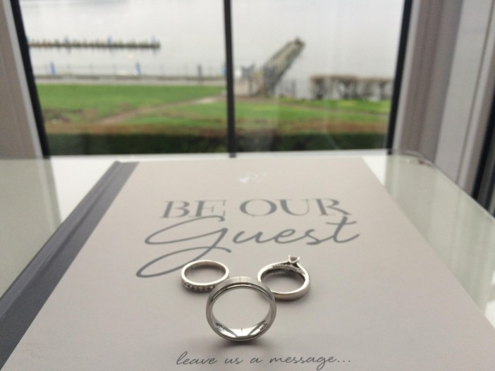 Wedding Guest book complete with wedding rings placed together to form Mickey Mouse