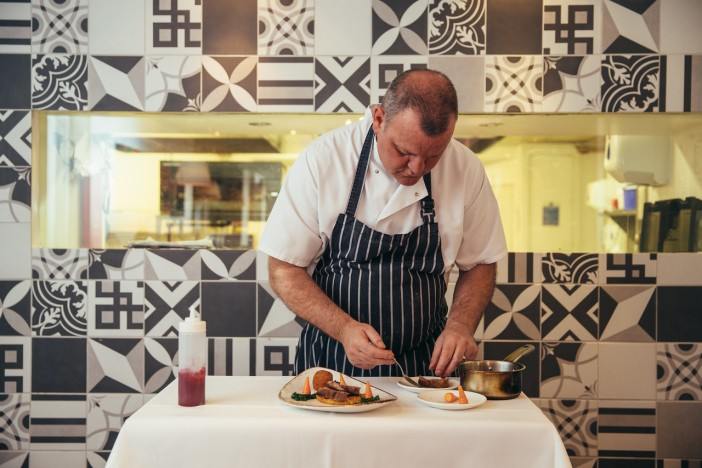 Nick - Head Chef, showing the team how to expertly create a dish